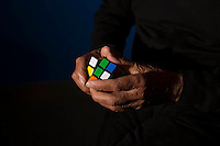 "JERSEY CITY, NJ - MAY 9: Erno Rubik, who invented the world's best selling toy, the Rubik's cube, poses for a portrait at the Liberty Science Center in Jersey City, New Jersey, on May 9, 2014. The Liberty Science Center created an exhibition titled ""Beyond Rubik's Cube,"" about Rubik's masterpiece and other work—on display through November of 2014. (Photo by Landon Nordeman)"