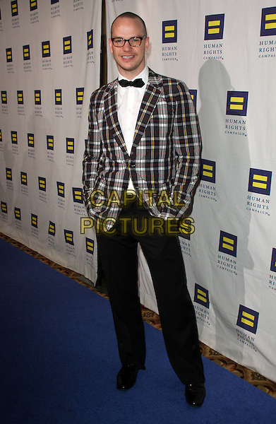T.R. KNIGHT.The Human Rights Campaign's Annual Los Angeles Gala & Hero Awards held at the Hyatt Regency Plaza Hotel, Century City, California, USA, .14th March 2009..full length black suit tie tartan plaid jacket white shirt .CAP/ADM/KB.©Kevan Brooks/Admedia/Capital PIctures