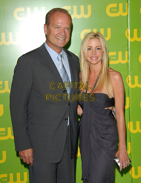 KELSEY GRAMMER & CAMILLE.The CW Launch Party held at Warner Brothers' Studios in Burbank, California, USA..September 18th, 2006.Ref: DVS.half length married husband wife grey gray suit blue dress.www.capitalpictures.com.sales@capitalpictures.com.©Debbie VanStory/Capital Pictures