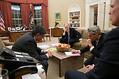"""Nov. 14, 2012.""""Aides listen on the speaker phone in the Oval Office as the President talks on the phone with President Mohammed Morsi of Egypt about the escalating violence in Gaza."""".Mandatory Credit: Pete Souza - White House via CNP"""
