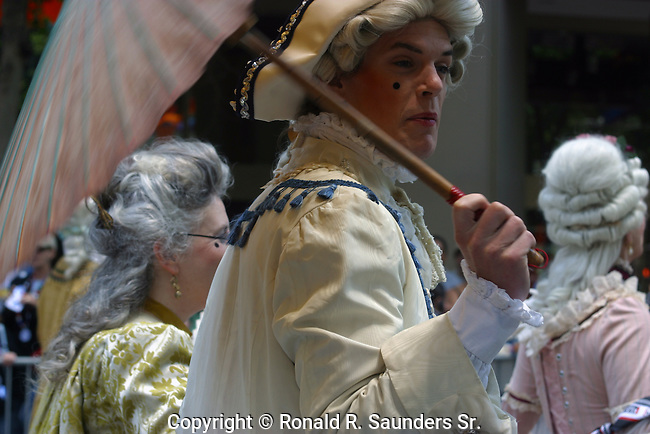 Gay Pride Parade participant dressed in 18th century English garb costume<br /> (2)