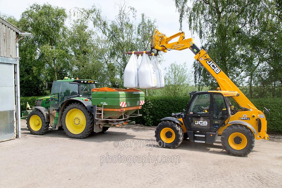 Loading compound nitrogen and sulphur fertilser into a Amazone spreader - Lincolnshire, June