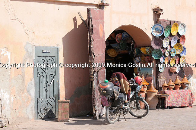 A store selling pottery and more in the main marketplace in Marrakesh, Morocco.