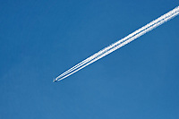 An aeroplane leaves a vapour trail in the sky over Aberporth