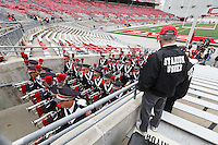 The Ohio State marching band leaves the stadium as they head to St. John Arena for the skull session before the start of a football game between The Ohio State University Buckeyes and the Kent State University Golden Flashes on Saturday, September 13, 2014 at Ohio Stadium in Columbus, Ohio. (Columbus Dispatch photo by Fred Squillante)