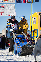 Elliot Anderson and team leave the ceremonial start line at 4th Avenue and D street in downtown Anchorage during the 2014 Iditarod race.<br /> Photo by Jim R. Kohl/IditarodPhotos.com