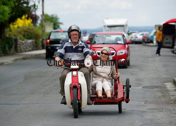 John Hogan drives Brenda Clarke in his home made side car during a vintage run as part of Feile an Samhraidh at Ballyvaughan. Photograph  by John  Kelly.