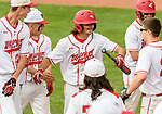 MIDDLETOWN, CT. 06 June 2018-060618BS572 - Wolcott's Nicholas Trager (22), center, celebrates with teammates after coming home to score a run in a big second inning during the CIAC Tournament Class M Semi-Final baseball game between Ledyard and Wolcott at Palmer Field on Wednesday afternoon. Wolcott beat Ledyard 9-4 and advances to the Class M final this weekend. Bill Shettle Republican-American
