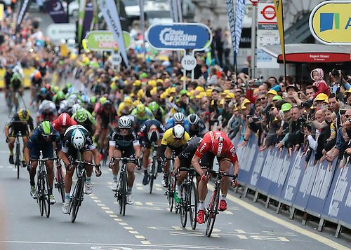 13.09.2015. London, England. Tour of Britain Stage Eight. London Finish. Andre Greipel of Lotto Soudal cuts in front of Elia Viviani of Team Sky and is stripped of his win handing the stage win to Elia Viviani of Team Sky