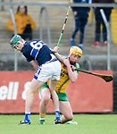 Aaron Moloney of Kilmaley in action against Tom Barry of Inagh-Kilnamona during their Minor A county final at Cusack Park. Photograph by John Kelly.