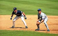 Boston Red Sox Greg Blosser leads off behind first baseman Todd Benzinger (36) during spring training circa 1992 at Chain of Lakes Park in Winter Haven, Florida.  (MJA/Four Seam Images)