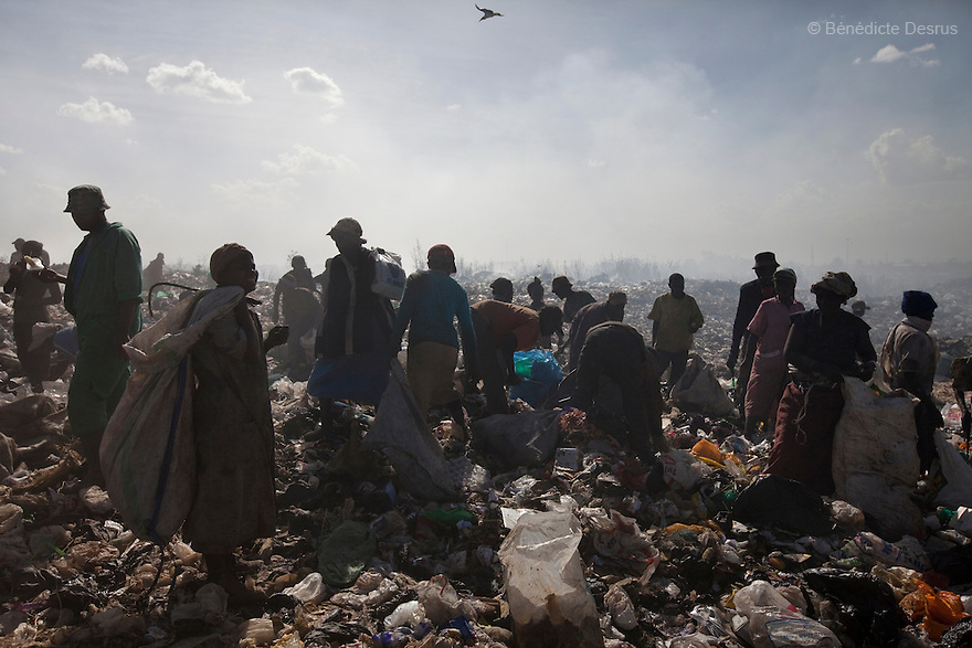 13 february 2013 - Dandora dumpsite, Nairobi, Kenya - Kenyan scavengers dig for items to sell and food waste to eat at the Dandora dumpsite, one of the largest and most toxic in Africa. Located near slums in the east of the Kenyan capital Nairobi, the open dump site was created in 1975 and covers 30 acres. The site receives 2,000 tonnes of unfiltered garbage daily, including hazardous chemical and hospital wastes. It is a source of survival for many people living in the surrounding slums, however it also harms children and adults' health in the area and pollutes the Kenyan capital. Photo credit: Benedicte Desrus