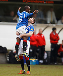 Kirk Broadfoot hoists up Sone Aluko after his stunning volley for Rangers third goal