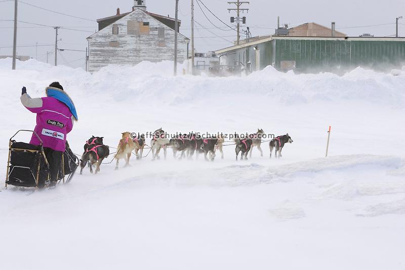 Dee Dee Jonrowe mushes in ground storm just outside Unalakleet 2006 Iditarod Western AK Winter