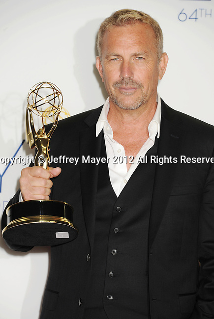 LOS ANGELES, CA - SEPTEMBER 23: Kevin Costner  poses in the press room at the 64th Primetime Emmy Awards held at Nokia Theatre L.A. Live on September 23, 2012 in Los Angeles, California.