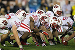 Wisconsin Badgers defensive linemen line up during the 2012 Rose Bowl NCAA football game against the Oregon Ducks in Pasadena, California on January 2, 2012. The Ducks won 45-38. (Photo by David Stluka)
