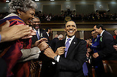United States President Barack Obama is greeted before his State of the Union address during a joint session of Congress on Capitol Hill in Washington, DC on February 12, 2013.     .Credit: Charles Dharapak / Pool via CNP