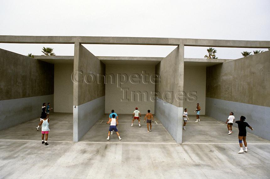 Group of three handball courts with men playing handball