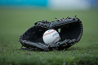A South Atlantic League game ball sits inside a baseball glove at Kannapolis Intimidators Stadium prior to the South Atlantic League game between the Hagerstown Suns and the Kannapolis Intimidators on May 6, 2016 in Kannapolis, North Carolina.  The Intimidators defeated the Suns 5-3.  (Brian Westerholt/Four Seam Images)