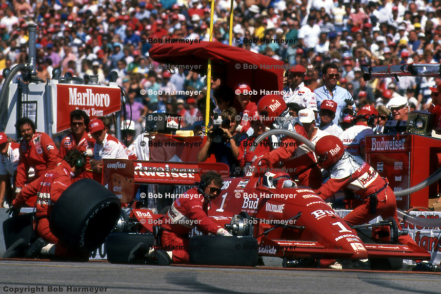 Bobby Rahal makes a pit stop in the Budweiser-sponsored Truesports Lola T88 during the 1988 IndyCar race at Burke Lakefront Airport in Cleveland, Ohio.