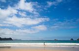 NEW ZEALAND, Coromandel Peninsula, Woman Playing in Water on Hahei Beach, Ben M Thomas