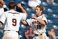 Tony Cooper (19) of the Pepperdine Waves is greeted by teammates during a game against the Oklahoma Sooners at Eddy D. Field Stadium on February 18, 2012 in Malibu,California. Pepperdine defeated Oklahoma 10-0.(Larry Goren/Four Seam Images)