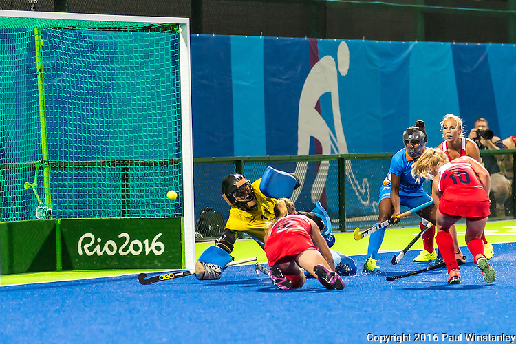 Katie Bam #16 of United States and Jill Witmer #10 of United States attempt to deflect the short corner shot during USA vs India in a women's Pool B game at the Rio 2016 Olympics at the Olympic Hockey Centre in Rio de Janeiro, Brazil.