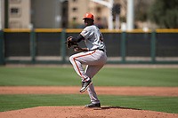 San Francisco Giants relief pitcher Wilson Santos (48) prepares to deliver a pitch to the plate during a Minor League Spring Training game against the Cleveland Indians at the San Francisco Giants Training Complex on March 14, 2018 in Scottsdale, Arizona. (Zachary Lucy/Four Seam Images)