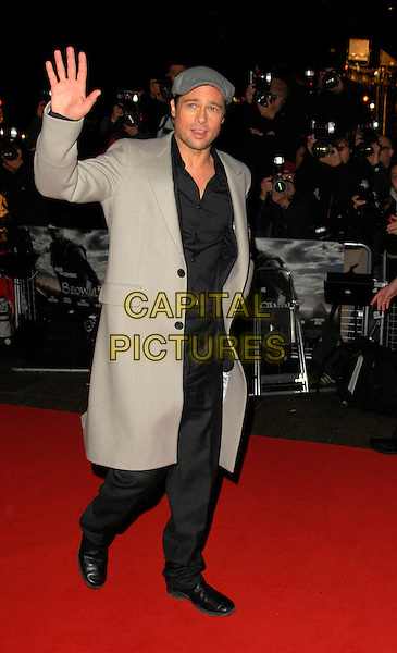"""BRAD PITT .The UK film premiere of """"Beowulf"""", Vue Leicester Square, London, England..November 11th, 2007.full length grey gray flat cap hat stubble facial hair beige coat jacket hand palm waving black .CAP/ CAN.©TCan Nguyen/Capital Pictures."""