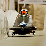 8 January 2016: Kaillie Humphries, piloting her 2-man bobsled for Canada, enters the Chicane straightaway on her second run, ending the day with a combined 2-run time of 1:53.91 and earning the silver medal at the BMW IBSF World Cup Championships at the Olympic Sports Track in Lake Placid, New York, USA. Mandatory Credit: Ed Wolfstein Photo *** RAW (NEF) Image File Available ***