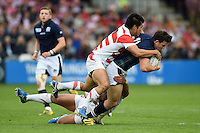 Matt Scott of Scotland  is tackled to ground by Shota Horie of Japan. Rugby World Cup Pool B match between Scotland and Japan on September 23, 2015 at Kingsholm Stadium in Gloucester, England. Photo by: Patrick Khachfe / Onside Images