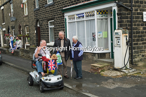 Greenfield Saddleworth Yorkshire UK. Disabled man with dog using a disabled vehicle.