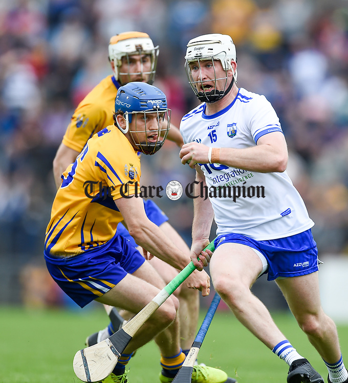 Shane Mc Nulty of Waterford  in action against Shane O Donnell of Clare during their Munster  championship round robin game at Cusack Park Photograph by John Kelly.