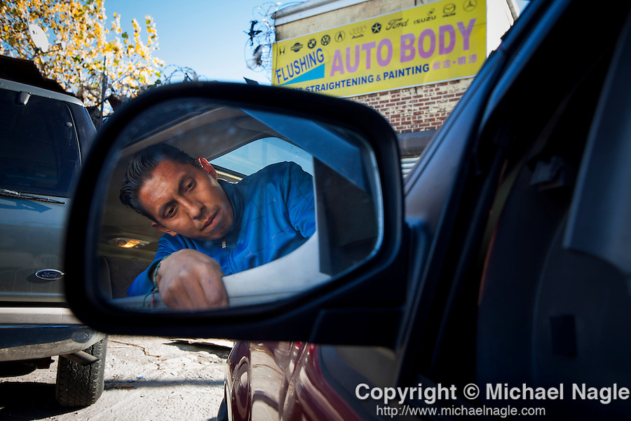 "QUEENS, NY -- NOVEMBER 18, 2013:  Jose ""Flaco"" Hernandez, 32, removes a door panel from a 1998 Ford Explorer on November 18, 2013 in Queens.  PHOTOGRAPH BY MICHAEL NAGLE FOR THE NEW YORK TIMES"