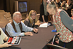 "May 11, 2013 - Garden City, New York U.S. -  Astronaut BUZZ ALDRIN, the second person to walk on the moon, speaks with an elderly woman, holding onto her walker, at the book signing for his new books ""Mission to Mars"" and the illustrated history of space exploration ""Look to the Stars.""  After Aldrin, the NASA astronaut engineer of Apollo 11 in 1969, gave a Sold Out lecture, people who bought his books at the museum book store could attend the book signing in the Cradle of Aviation Museums's LEM room."