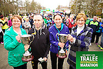 Elma Walsh presenting the Donal Walsh memorial cup to Gary O'Hanlon the Mens winner  and Rita Hickey presenting the Adrian Hickey memorial cup to the first woman home  Ann Marie Holland who took part in the Kerry's Eye Tralee International Marathon on Sunday 16th March 2014.