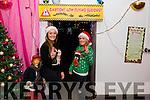 Elfs Aoife and Ciara O'Mahony at the Deenagh Lodge smiling while working hard helping Santa.