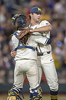 Michigan Wolverines pitcher Jeff Criswell (17) celebrates with catcher Joe Donovan (0) after beating the Vanderbilt Commodores in Game 1 of the NCAA College World Series Finals on June 24, 2019 at TD Ameritrade Park in Omaha, Nebraska. Michigan defeated Vanderbilt 7-4. (Andrew Woolley/Four Seam Images)