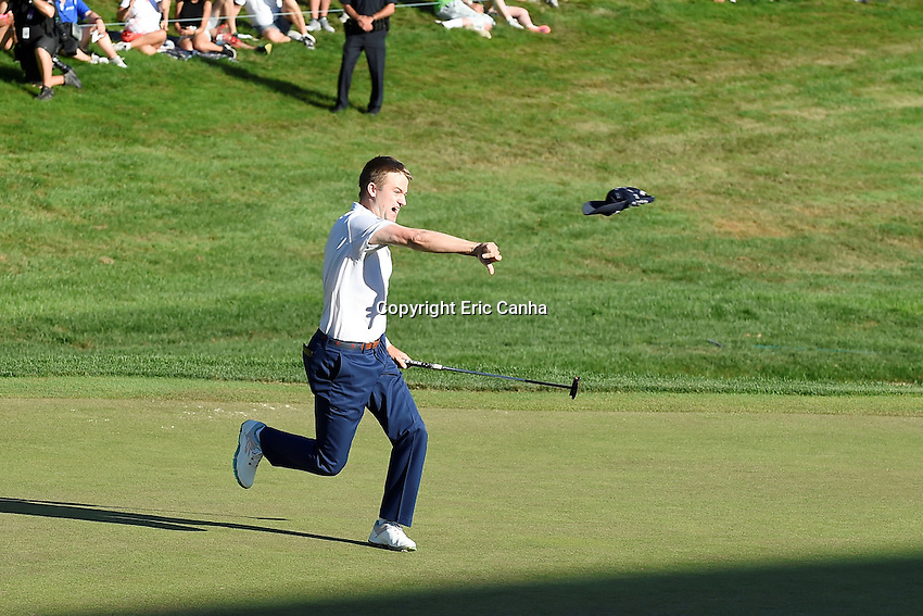August 7, 2016:  Russell Knox of Scotland throws hit hat in celebration of winning the Travelers Championship at TPC River Highlands in Cromwell CT.  Russell Knox of Scotland wins the championship shoting -2 on the day to finish -12. Eric Canha/CSM