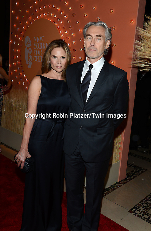 Susan and Tony Gilroy attends the New Yorkers for Children 15th Annual Fall Gala to Benefit Youth in Foster Care which is presented by Chloe and David Yurman at Cipriani 42nd Street on September 30,2014 in New York City. <br /> <br /> photo by Robin Platzer/Twin Images<br />  <br /> phone number 212-935-0770