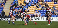 Warrington Wolves' Daryl Clark is tackled by Wigan Warriors' Sam Powell (right) and Oliver Gildart <br /> <br /> Photographer Stephen White/CameraSport<br /> <br /> Rugby League - Coral Challenge Cup Sixth Round - Warrington Wolves v Wigan Warriors - Sunday 12th May 2019 - Halliwell Jones Stadium - Warrington<br /> <br /> World Copyright © 2019 CameraSport. All rights reserved. 43 Linden Ave. Countesthorpe. Leicester. England. LE8 5PG - Tel: +44 (0) 116 277 4147 - admin@camerasport.com - www.camerasport.com