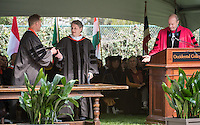 PIMCO Group Chief Investment Officer Daniel Ivascyn '91 receives an honorary degree from Elbridge Amos Stuart Professor of Economics Robby Moore, Trustee Steven Olson and President Jonathan Veitch at Occidental College's 133rd Commencement at the Remsen Bird Hillside Theater, on Sunday, May 17, 2015.<br /> (Photo by Marc Campos, Occidental College Photographer)