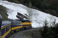 The Alaska Railroad's Coastal Classic train travels past an avalanche chute.