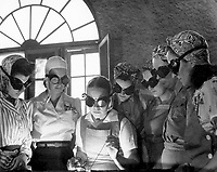 Secretaries, housewives, women from all over central Florida are getting into vocational schools to learn war work. Typical are these in the Daytona Beach branch of the Volusia country vocational school. April 1942.<br /> <br /> Credit: National Archives and Records Administration