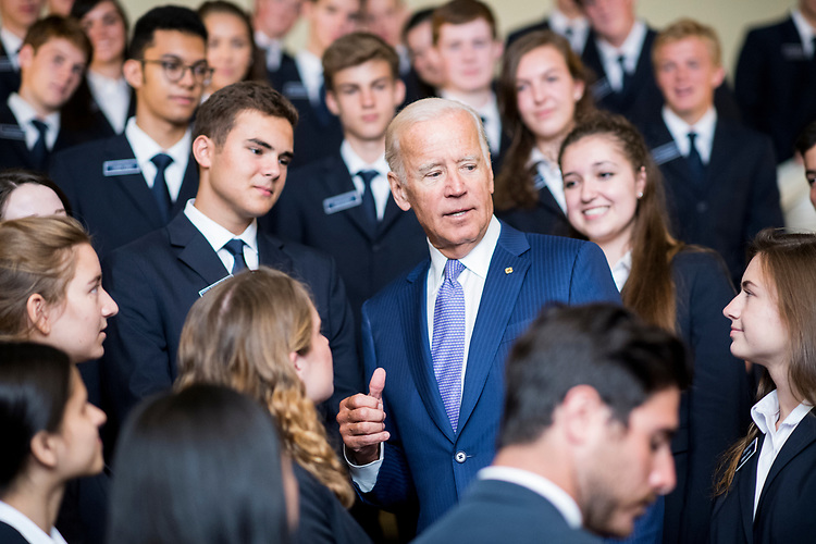 UNITED STATES - JULY 11: Former Vice President Joe Biden speaks to Senate pages after posing for a group photo during his visit to the Capitol on Tuesday, July 11, 2017. (Photo By Bill Clark/CQ Roll Call)