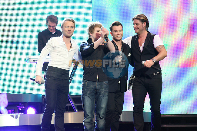 Eoghan Quigg singing with Boyzone at the 2008 Cheerios Childline Concert in the O2...Photo NEWSFILE/Jenny Matthews.(Photo credit should read Jenny Matthews/NEWSFILE)....This Picture has been sent you under the condtions enclosed by:.Newsfile Ltd..The Studio,.Millmount Abbey,.Drogheda,.Co Meath..Ireland..Tel: +353(0)41-9871240.Fax: +353(0)41-9871260.GSM: +353(0)86-2500958.email: pictures@newsfile.ie.www.newsfile.ie.FTP: 193.120.102.198.