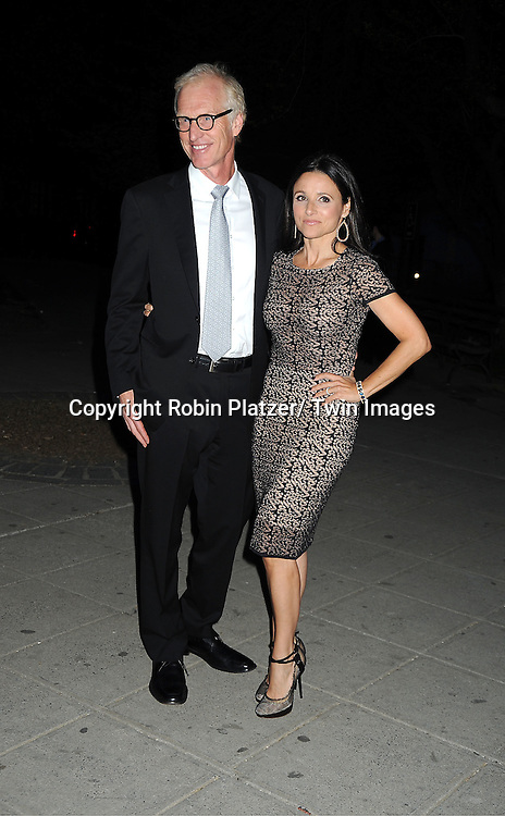 Julia Louis-Dreyfus and husband Brad Hall arrive at The Vanity Fair Tribeca Film Festival Party at The State Supreme Courthouse at 60 Centre Street on April 17, 2012 in New York City.
