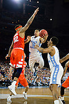 02 APR 2016: Guard Marcus Paige (5) of the University of North Carolina drives to the basket against Center Dajuan Coleman (32) of Syracuse University during the 2016 NCAA Men's Division I Basketball Final Four Semifinal game held at NRG Stadium in Houston, TX. North Carolina defeated Syracuse 83-66 to advance to the championship game.  Brett Wilhelm/NCAA Photos