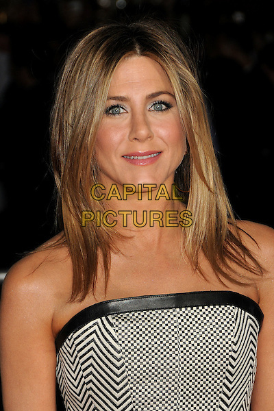"Jennifer Aniston.""Wanderlust"" Los Angeles Premiere held at the Regency Village Theatre, Westwood, California, USA..February 16th, 2012.headshot portrait black leather trim strapless white print check  .CAP/ADM/BP.©Byron Purvis/AdMedia/Capital Pictures."