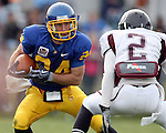 BROOKINGS, SD - NOVEMBER 6: Matt Hylland #24 of South Dakota State University looks to make a move past Howard Scarborough #2 of Missouri State in the second quarter of their game Saturday afternoon at Coughlin Alumni Stadium in Brookings. (photo by Dave Eggen/Inertia)